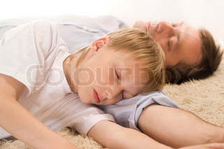 dad and son sleeping on the carpet