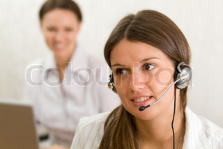 Young girl with headset in the office