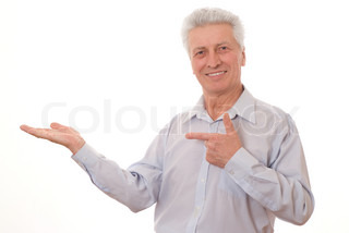 Mature business man holding hand out at copyspace over white background