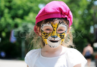 Cute little girl with painted face
