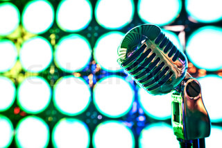 Retro microphone on stage in restaurant Blurred background