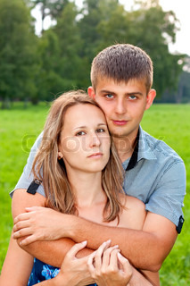 Young happy couple hugging on the outdoors