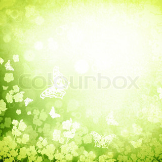 Spring or summer grunge background with butterflies and flowers silhouette, copyspace for your text