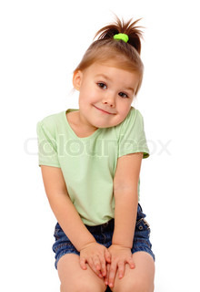 Cute little girl is sitting on floor and smile