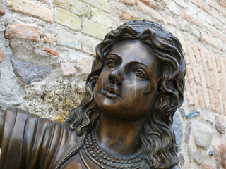 Old statue of a grieving woman