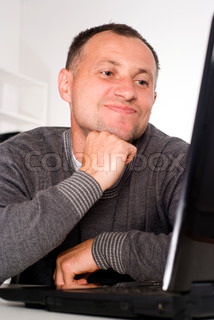 adult man with laptop