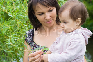 portrait of a happy mom and littledaughter at nature