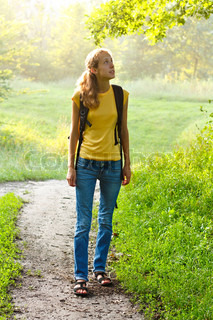 Happy Woman Tourist Walking in Summer Nature