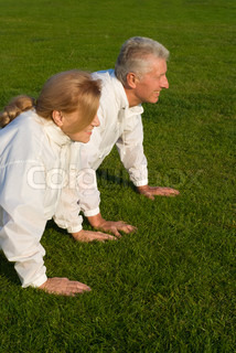 old family pushing up on grass