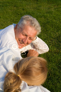 elderly couple on grass