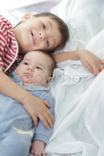 young brother and newborn sister portrait