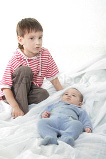 young brother and newborn baby portrait