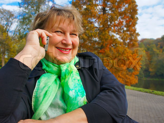 Middle-aged woman talking on the phone