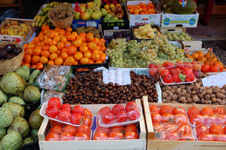 Fresh vegetables, beans, honey and fruits at a farmer's market