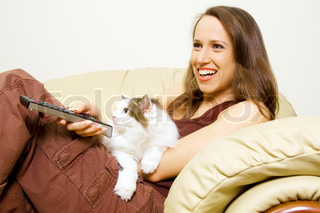 woman watching tv with her cat