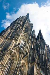 Towers of Koelner Dom Cologne Cathedral over blue sky