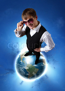 Young businessman standing on the planet earth model