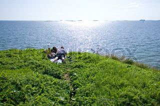 A couple lying at a grass at the Suomenlinna island at Helsinki
