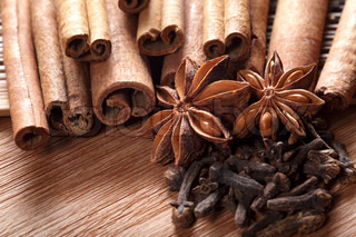 Herbs and Spices over wooden background