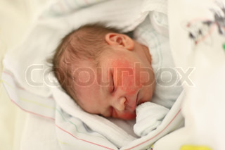 Newborn baby minutes after the birth