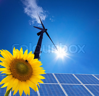 wind power alternative energy through windmill with blue hmmel