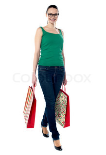 American beauty holding shopping bags, walking pose