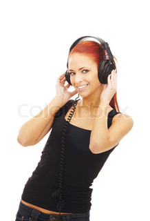 Young attractive woman listening to the music isolated on white