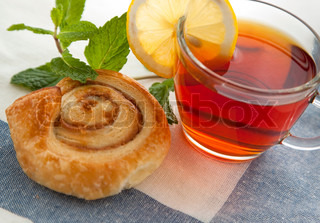 Cup of tea with cinnamon Danish bun