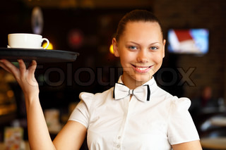 Portrait of young waitress holding a tray