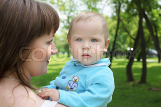 Mother with her baby boy outside