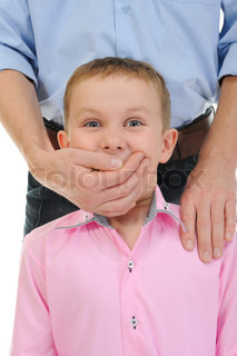 man closes a mouth a hand to the boy