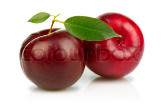 Ripe plums fruits with green leaves isolated on white