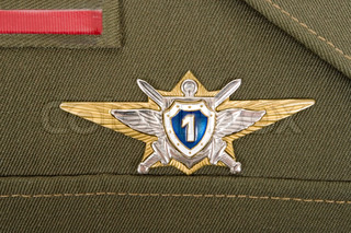 Russian military badge on the green uniform