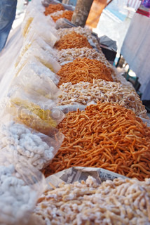 shop of traditional sweets on indian market