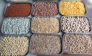 Indian pulses and cereals on display in a shop at bangalore market