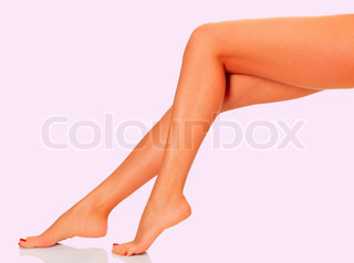 Female legs on pink background