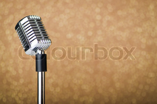 Old vintage microphone on background