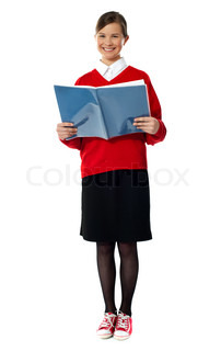 Smiling girl standing with exercise book