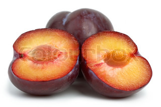Violet plums: whole and two halves