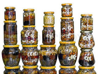 glass jars with nuts and honey