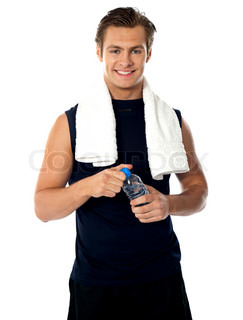 Young athlete posing with water bottle