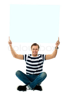 Seated man showing blank signboard against white background