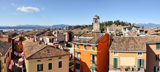 Panoramic aerial view on houses and roofs of Sirmione - small town on Lake Garda in Northern Italy.