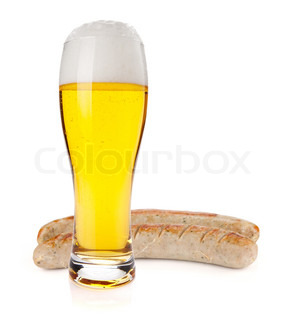 Lager beer glass and two grilled sausages