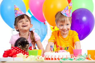 happy children celebrating birthday party with opening gift box