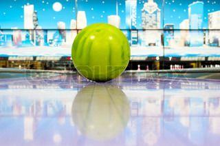 Sphere ball standing on bowling lane