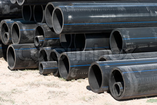 Pipes for water in a stack on field