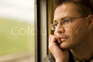 Thinking man looking out of window,  in the train