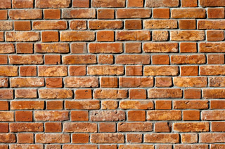 Old red brick wall as background