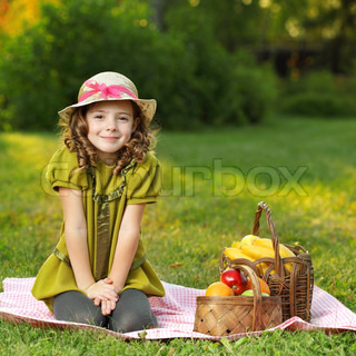 girl with fruit in park
